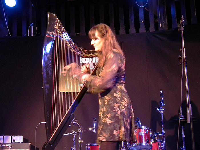 Phamie Gow playing her electric harp